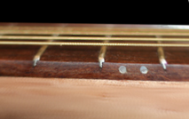 Look at the action when buying a classical guitar